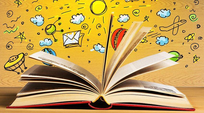 un libro aperto con sfondo giallo e disegni infantili